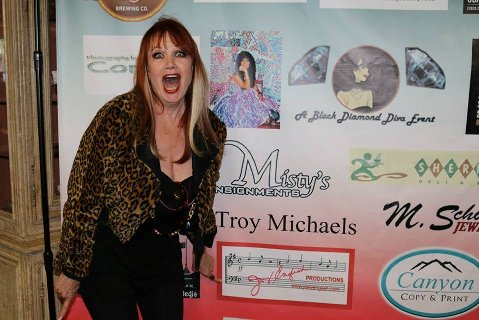 Joey in front of her sponsorship banner May 7 for P.S.H.S. at Misty's